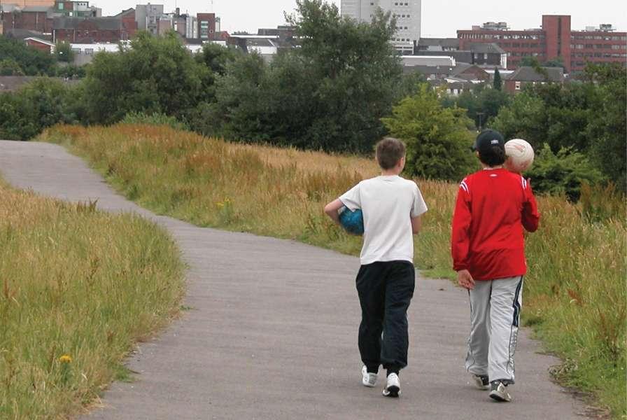 Boys Walking On Pathway