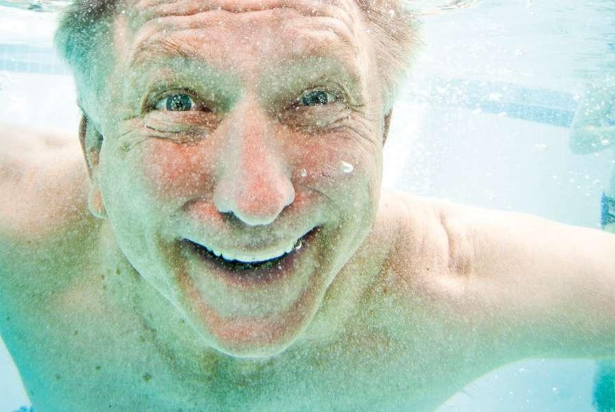 Senior Swims Under Water
