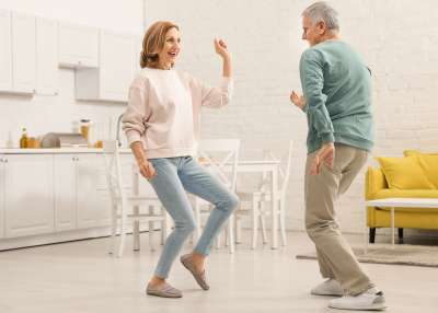 Older Couple Dancing In Kitchen
