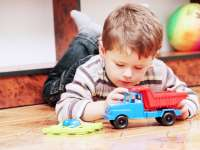 Boy Playing With Truck News