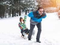 Winter Couple Sledding