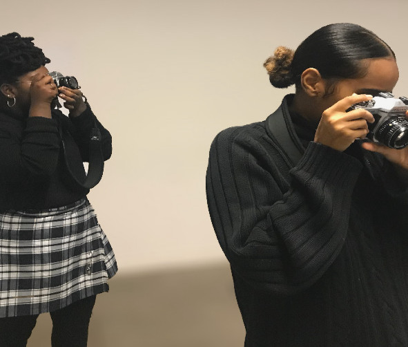 Two photographers taking photos in a gallery