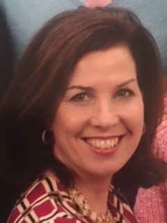 Photo of Kathie Iannuzzi, smiling.