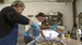 Caption: Jeff Post (front) and a fellow co-worker pour epoxy for a faceted glass window, Credit: Terese Tenseth
