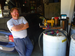 Caption: Ken Kirkland in his garage, where he produces homemade biodiesel from restaurant-used vegetable oil., Credit: Photo by Roisin Hunt