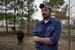 Caption: Ben Haines & his cow