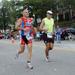 Caption: John Rymes (l) running in the Lake Placid Ironman Triathlon, 2011