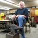 Caption: Bob Jordan with his anvil, Credit: JP Davidson