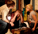 Caption: Peter (Cory Anderson) and Agnes (Molly O'Neill) struggle to convince R.C. (Erin McConnell) that the bugs are real.