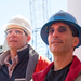 Caption: Andrew Fisher (left) is on a drilling cruise to understand how water moves through the ocean crust, and what kind of life is thriving down there.  A smaller boat brought supplies for the CORKs to the JOIDES Resolution on some choppy seas.