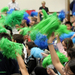 Caption: Elementary schoolers from New Jersey celebrate Rutgers Ocean Day in mid-April by cheering and waving their pompoms in the air. Credit for all photos: Sage Lichtenwalner.  The students from 8 New Jersey schools took time at this station to write their wish, Credit: Sage Lichtenwalner.