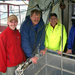 Caption: Wetlab company members encircle the 'moonpool' on the aft deck of the Pontoon Boat of Science where they suspend and test their instruments. L to R: Corey Koch, Ron Zaneveld, Alex Derr and Ian Walsh.  One big challenge of making sensors that stay in the o
