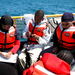 Caption: The Lake Sturgeon Bowl team from Clara Mohammed High School in Milwaukee collect data aboard a hypothesis-testing cruise on Lake Michigan. Credit: Carmen Aguilar.  Newman Catholic High School students listen to the Ocean Gazing podcast (!) before the star, Credit: Carmen Aguilar.