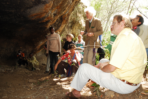 Caption: David Coulson at a rock art site in Nairobi Park (sitting), Credit: Paula Kahumbu