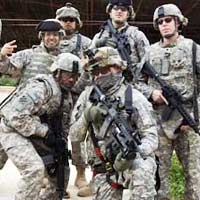 Caption: U.S. soldiers in Iraq, Credit: Jake Warga