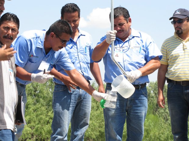 Caption: Water treatment plant employees test a raw water sample as part of a two-day training workshop funded by NADBANK., Credit: HERNAN ROZEMBERG