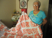 Caption: Donna Manning and one of her recent quilts.