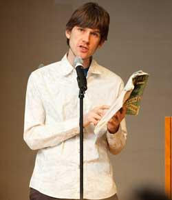 Caption: Sam Kean reading from his first book at CHF's inaugural Science Cabaret., Credit: Conrad Erb.