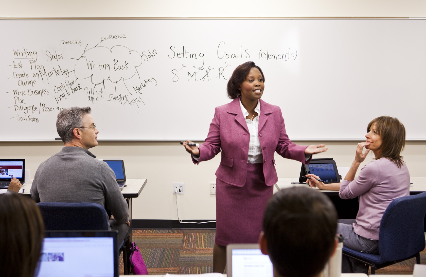 Caption: A class at the University of Phoenix's Hohokam campus in Arizona. Phoenix is the nation's largest for-profit university and largely serves working adults. , Credit: Brian Pobuda/University of Phoenix