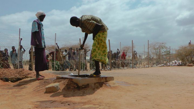 Caption: A Somali refugee drinks water from a well in the U.N. refugee camp of Dadaab, Kenya. In 2011, a severe drought plagued the region, forcing over one million Somalis to flee to neighboring countries.