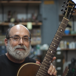 Caption: Author John Thomas being interviewed at Brooklyn's Retrofret Guitars., Credit: Emon Hassan
