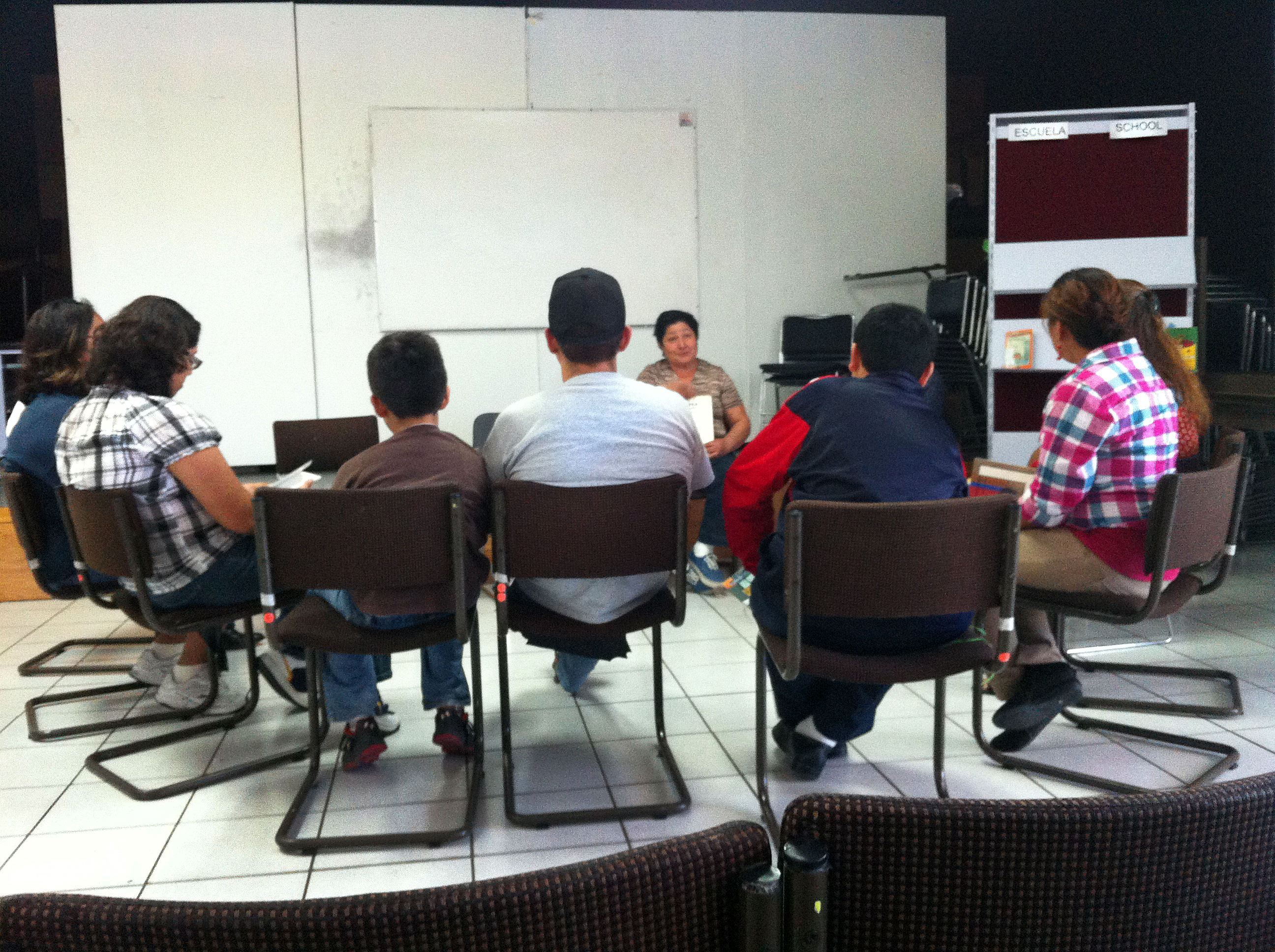Caption: Support group meeting for foreign students and their parents at the Biblioteca Benito Juárez in Tijuana., Credit: Joel Medina