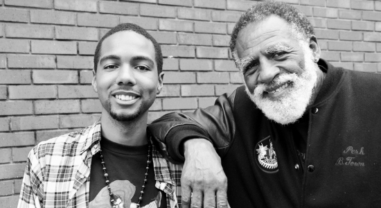 Caption: Author Myles Bess with community leader Arnold Perkins., Credit: Photo: Brett Myers - Youth Radio/ BY-NC-SA