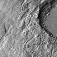 Caption: Did runoff from snowfall carve this river basin on Mars?, Credit: NASA