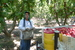 Caption: Farmworker Eduardo Amezcua stands next to a water cooler after picking nectarine at HMC Farms outside of Selma., Credit: Lisa Morehouse