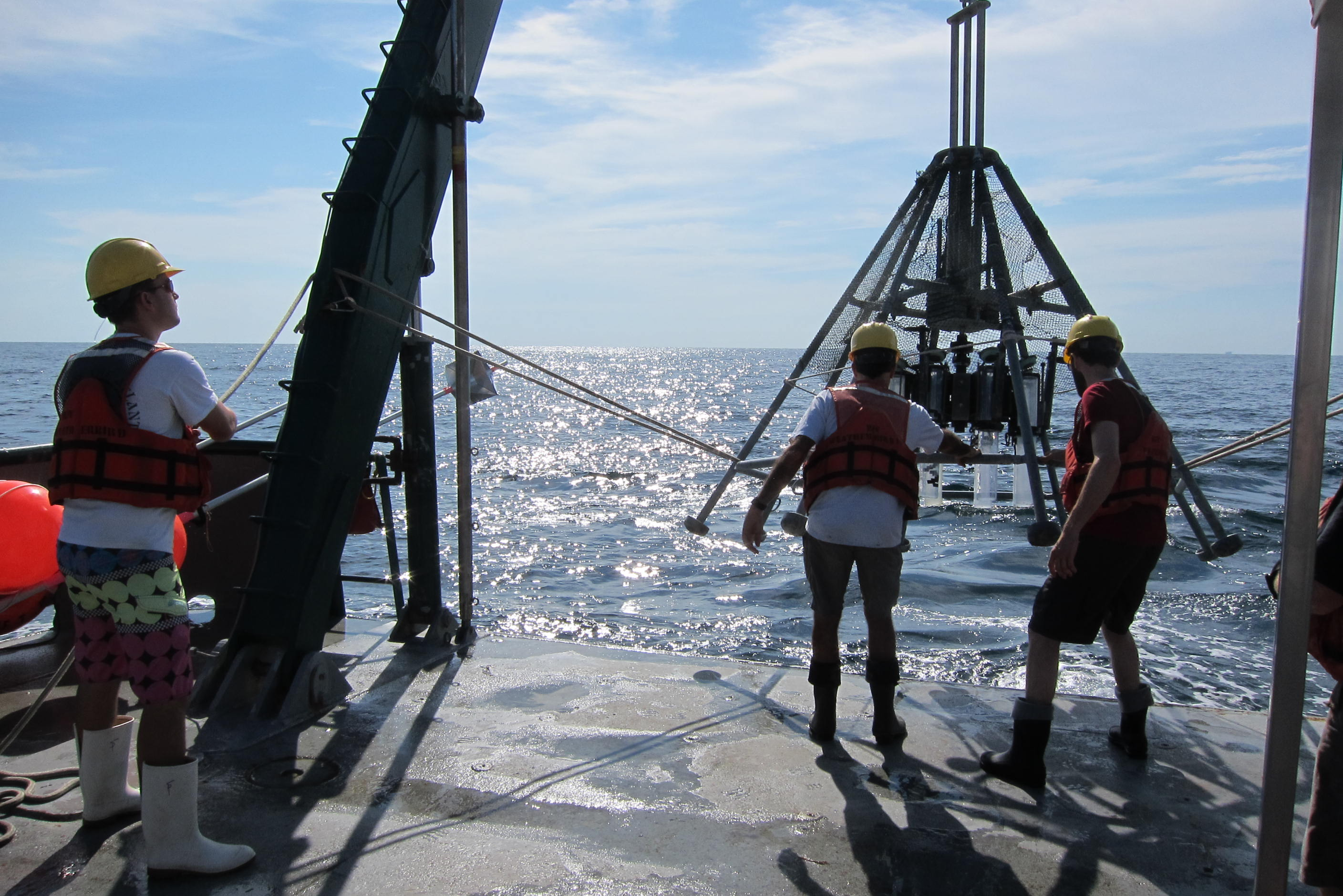 Caption: Researchers prepare to take samples of the ocean floor using a multicore device.