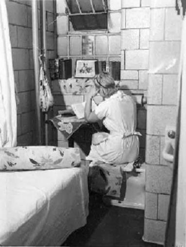 Caption: A woman prisoner in a cell at the Women's House of Detention, a women's-only prison run by the Women's Prison Association, in the 1940s. , Credit: Women's Prison Association