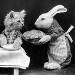 Caption: A rabbit serves a meal to three kittens (Harry Whittier Frees, c1870).