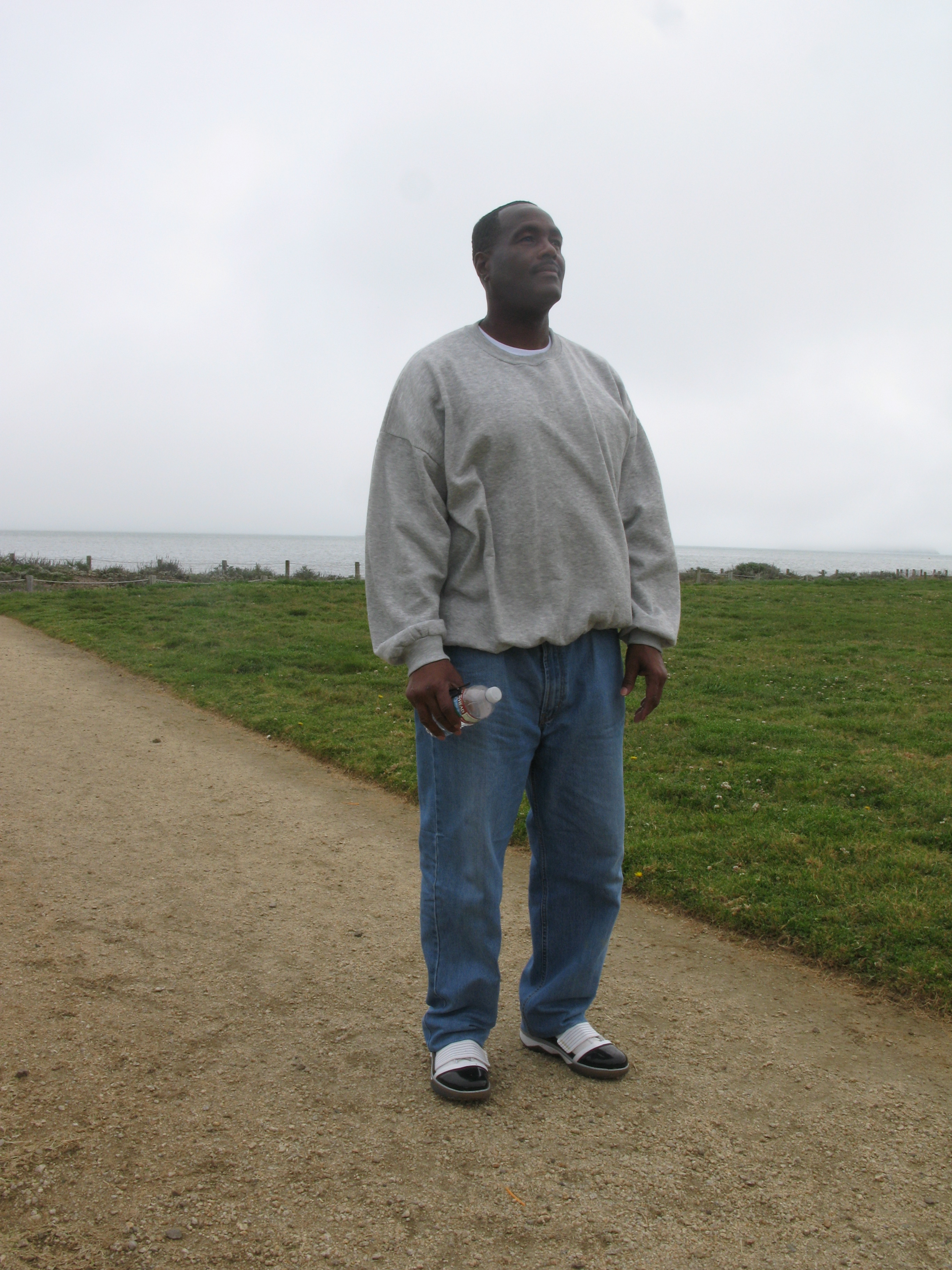 Caption: Curtis Penn takes his first walk of freedom on his release day from San Quentin, at Chrissy Field in San Francisco., Credit: Nancy Mullane