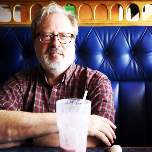 Caption: Historian Tom Hanchett at a booth at El Pulgarcito. , Credit: Tanner Latham