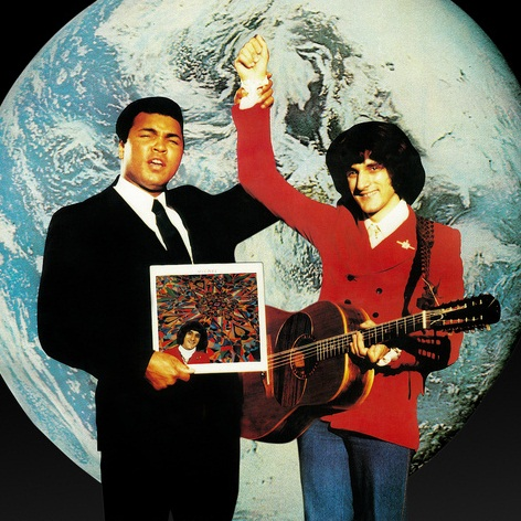 Caption: Artwork for Michel's album. Photo features Muhammad Ali and Michel.