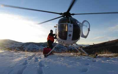 Caption: FWP Wildlife Biologist Kelly Proffitt boards the helicopter during the February 2011 elk capture.