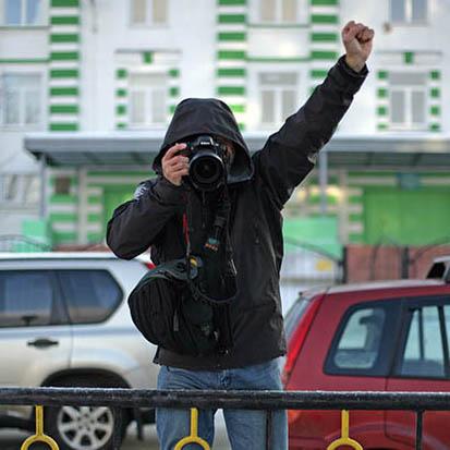 Caption: Photographer Dima Sharomov, Credit: Greenpeace