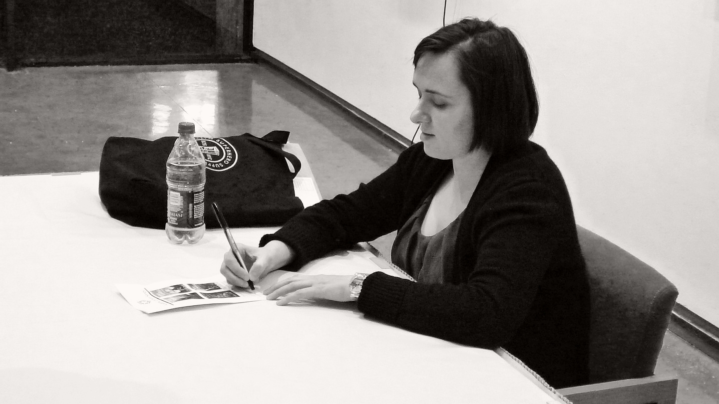 Caption: Sarah Vowell signing books after a lecture at Lamar Univ. in Beaumont, Texas