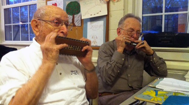 Caption: Jack Hopkins, left, and Frank Jamison, right, jam together at weekly meetings of the Capital Harmonica Club, which Jack founded in 1991., Credit: Eric Shimelonis