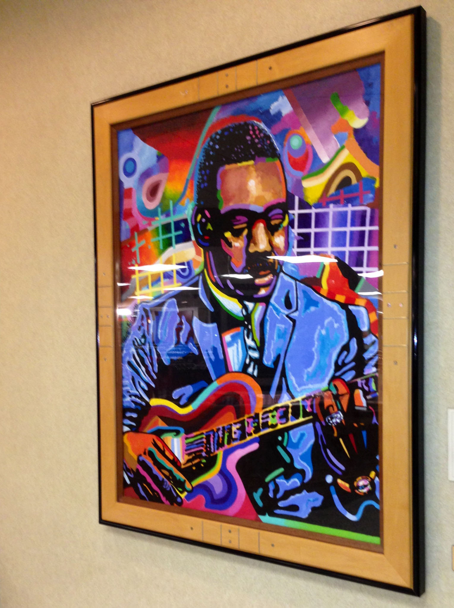 Caption: Joel Washington painted this portrait of jazz musician Wes Montgomery, which hangs in the Indiana Memorial Union., Credit: Lacy Scarmana