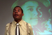 Caption: Mike Wiley performing Dar He: The Story of Emmett Till