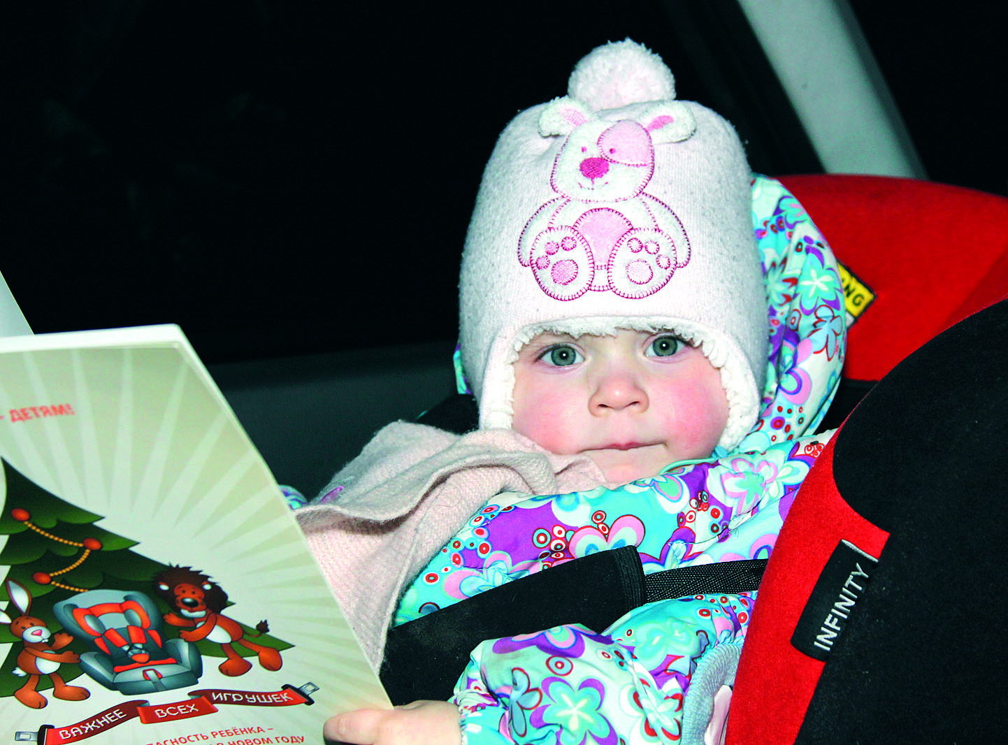 """Caption: The NGO """"Road Safety Russia"""" has been using photos like this to promote child car seat use., Credit: Road Safety Russia"""