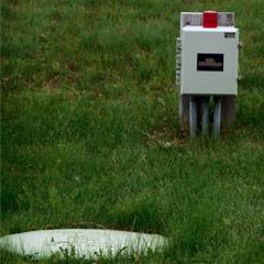 Caption: A pumptank manhole and alarm