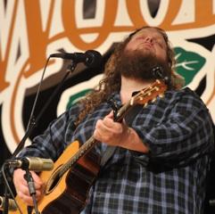Caption: Matt Andersen rocks the WoodSongs Stage solo.