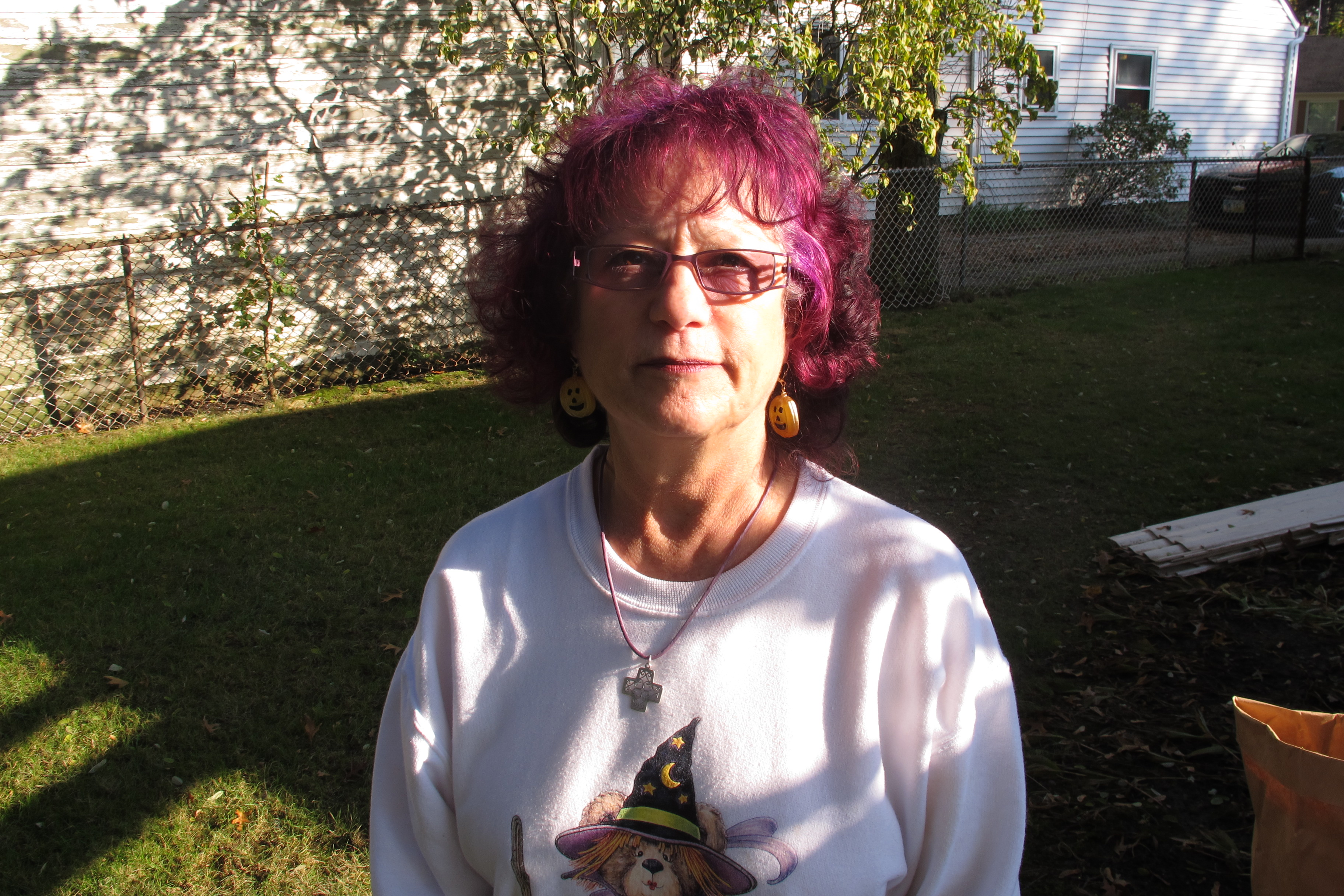 Caption: Marilyn Lombardo in her backyard., Credit: Brian Bull, WCPN.