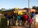 Caption: Children wait at school bus stop in Foley, Alabama., Credit: Javier Aparisi/Radio Bilingüe