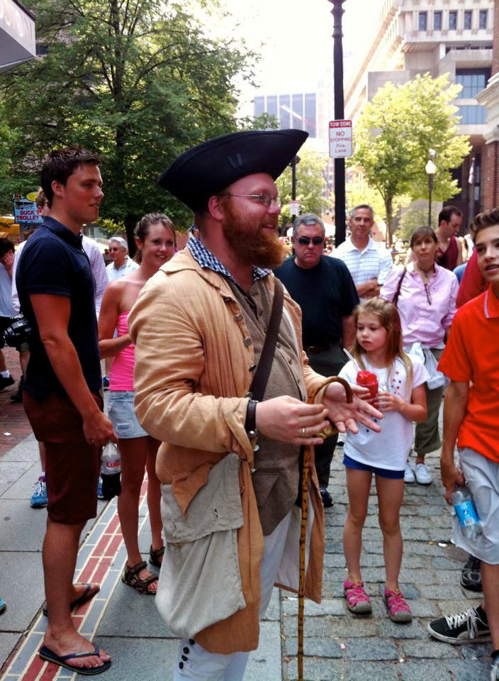 Caption: Freedom Trail tour guide, Matt Wilding, in costume as Ebenezer Mackintosh, giving a tour of Boston's historic North End neighborhood, Credit: Christina Gustafson