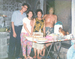 Caption:  (From left) Maria's father, mother, grandmother, and grandfather at their home in Manila - the same home where they once encountered a supernatural creature. Maria learned about many traditional Filipino beliefs from her grandmother, Conchita Carpio., Credit: Courtesy of the Caoagdan family
