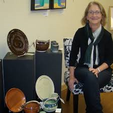 Caption: NW Minnesota Artist - Betsy Saurdiff and an example of her pottery work.