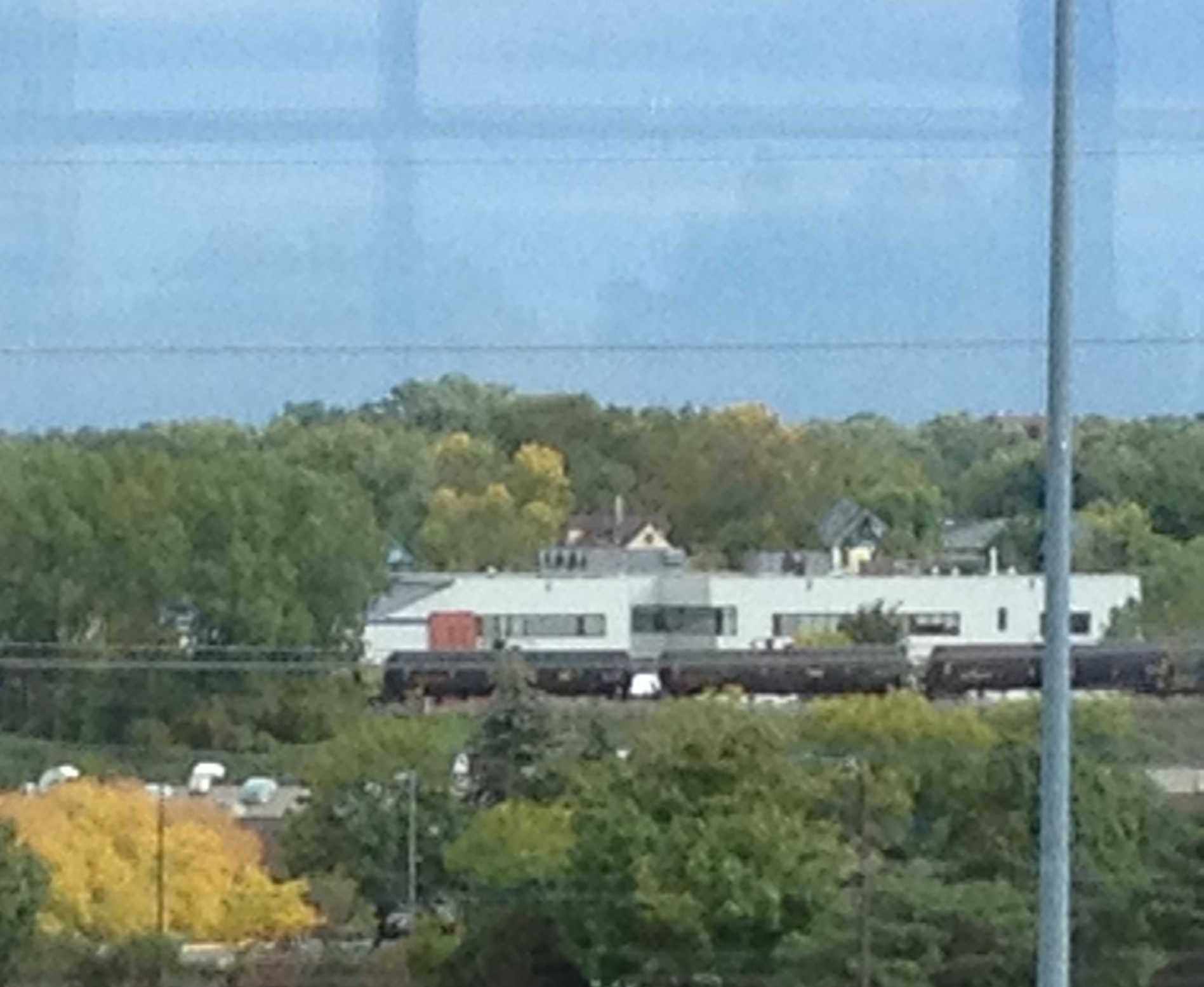 Caption: An oil train waits for traffic to clear in St. Paul., Credit: Melissa Townsend